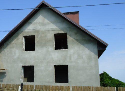 Дом отделанный штукатуркой